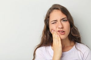 Sometimes, erupting wisdom teeth can cause pain and difficulty chewing, in which case extraction by oral surgery will likely be necessary.